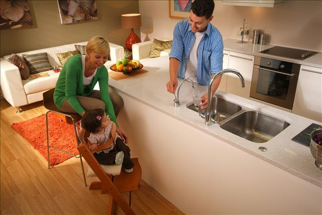 Man Using Cold Filtered Water Tap